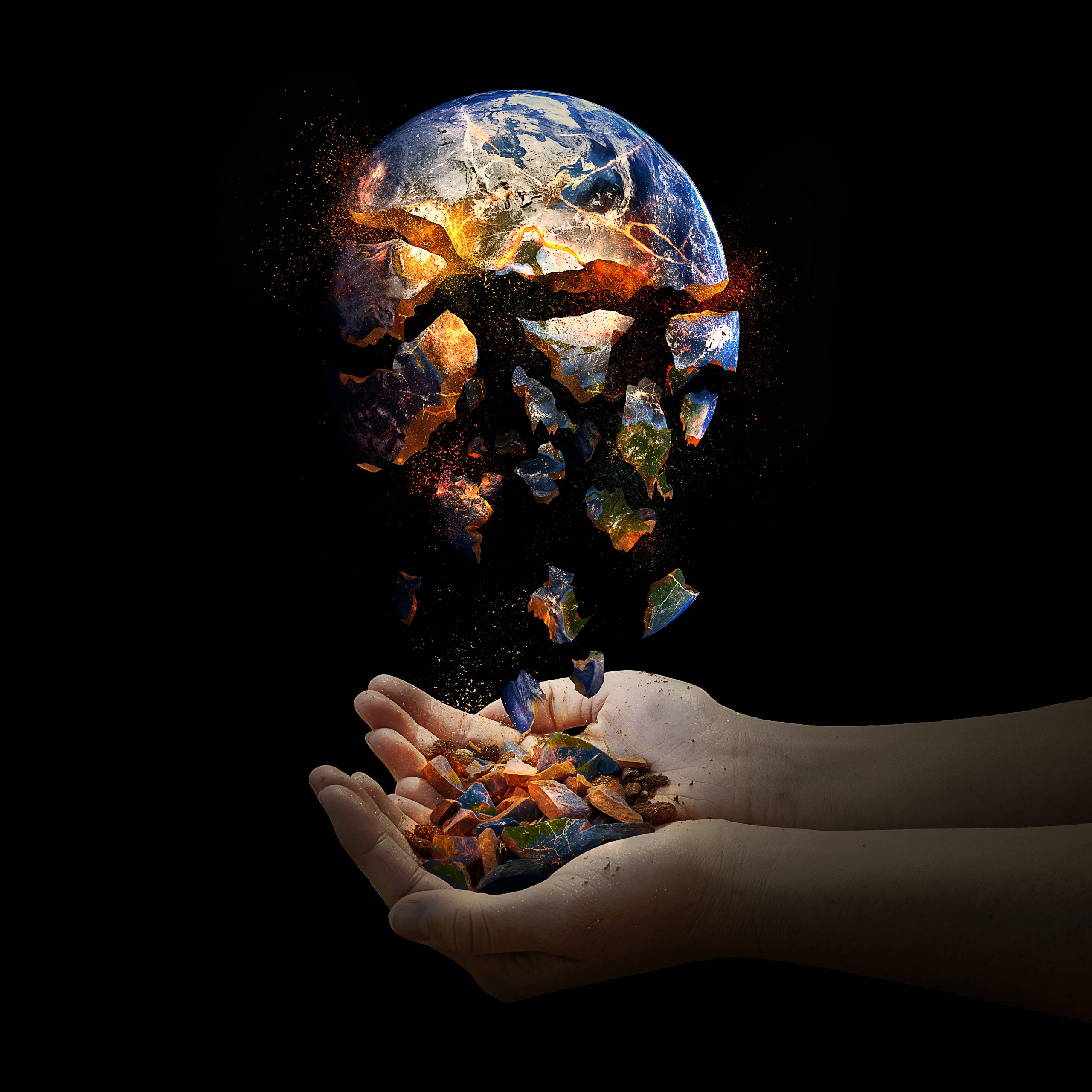 The whole world falls apart but two open hands catch the pieces.